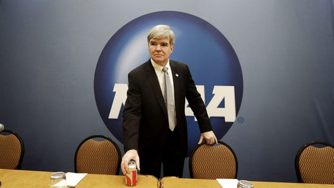 NCAA President Mark Emmert arrives to speak to reporters at the organization's annual convention Thursday in Grapevine, Texas. Emmert delivered his state of the association address on the second day of the group's convention, where several reform measures are on the agenda in the wake of high-profile scandals. The board could make sweeping changes this week, including rules about communicating to recruits
