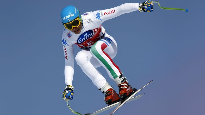 Italy's Christof Innerhofer speeds down the course on his way to win an Alpine Ski World Cup men's downhill, in Wengen, Switzerland, Saturday.