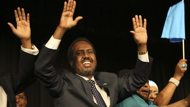 Somali President Hassan Sheikh Mohamud waves at the crowds during a Somalia convention at the Minneapolis Convention Center.