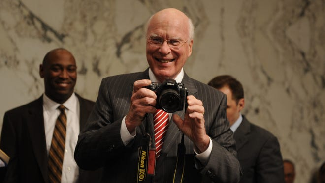 Sen. Patrick J. Leahy, a Vermont Democrat who chairs the Judiciary Committee, pulls out his camera during a break in the confirmation hearings of  Supreme Court Justice Sonia Sotomayor in July 2009.