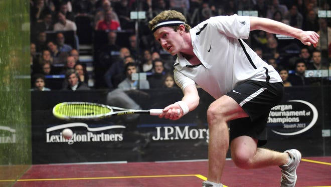 Todd Harrity competes during his match against Tom Richards during a J.P. Morgan Tournament of Champions at Grand Central Station in New York.