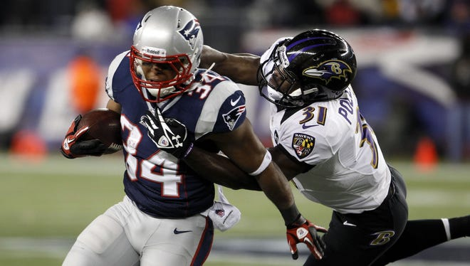 New England Patriots running back Shane Vereen (34) is tackled by Baltimore Ravens strong safety Bernard Pollard (31) during the first quarter of the AFC championship game at Gillette Stadium.