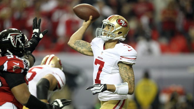 San Francisco 49ers quarterback Colin Kaepernick (7) throws the ball against the Atlanta Falcons during the third quarter in the NFC Championship game at the Georgia Dome.