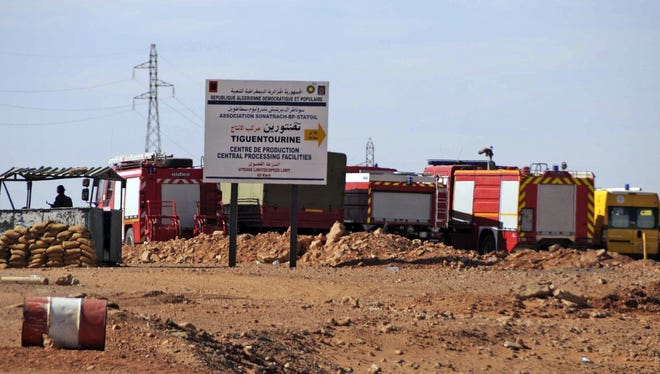 Rescue vehicles are stationed Sunday near the Algerian gas plant where hostages were taken.