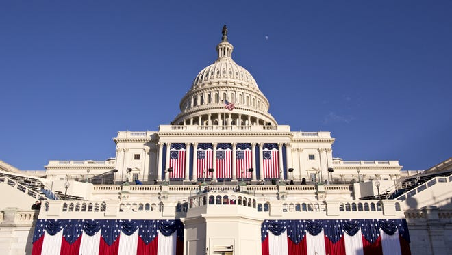 The West Front of the U.S. Capitol is dressed in red, white and blue the day before President Obama's public inauguration festivities on Monday.