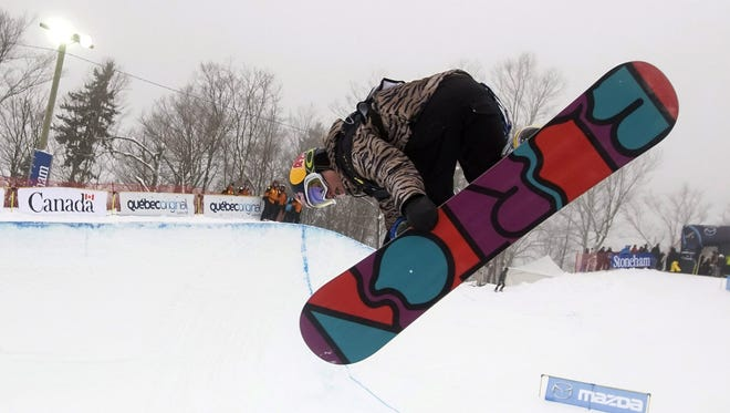 Arielle Gold performs in the women's halfpipe competition on Sunday at the FIS Snowboard World Championship in Stoneham, Quebec.  Gold won the competition.