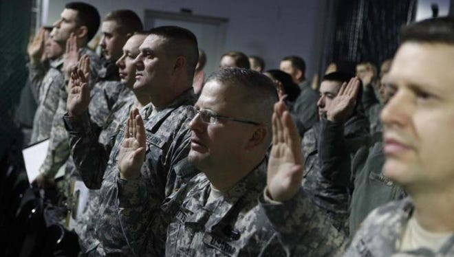 Soldiers and airmen from the Pennsylvania National Guard are processed and sworn in as special police by the Metropolitan Police Department at the District of Columbia National Guard Armory in Washington, D.C., on Friday, Jan. 18, 2013. (Gannett, Mike Marones/Military Times)