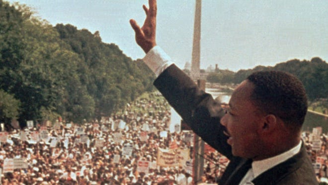 Martin Luther King Jr. acknowledges the crowd at the Lincoln Memorial on Aug. 28, 1963.