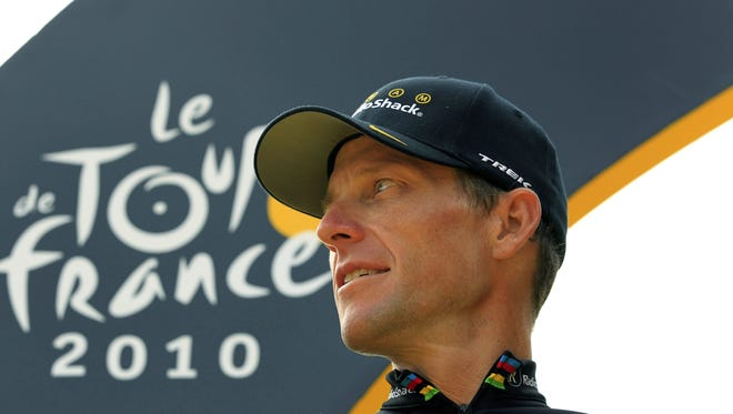 In this July 25, 2010, file photo, Lance Armstrong looks back on the podium after the 20th and last stage of the Tour de France cycling race in Paris. Armstrong was stripped of his seven Tour titles.