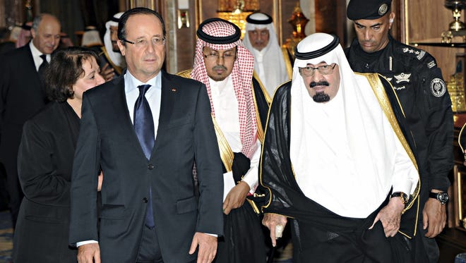 King Abdullah of Saudi Arabia with French President Francois Hollande, who went to the desert kingdom in early November for talks about Syria and Iran.