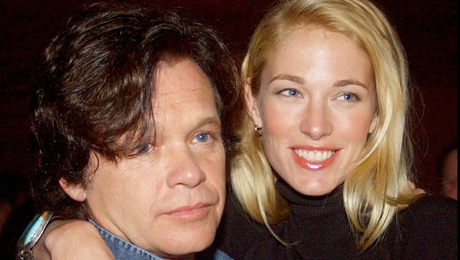 Elaine Irwin, shown here in 2002 with then-husband John Mellencamp, is engaged to IndyCar team owner Jay Penske.