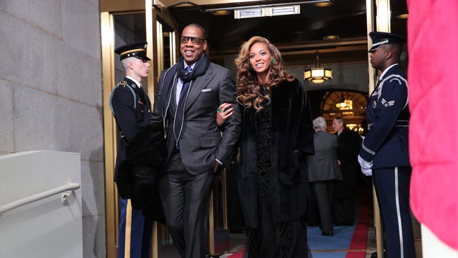 Jay-Z and Beyonce arrive at the presidential inauguration on the West Front of the U.S. Capitol Jan. 21 in Washington.
