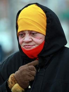 Bundled against the cold, Sandra Edwards of Covington, Ky., looks for a shelter in northern Kentucky. She is homeless and needed a place to stay overnight when temperatures are expected to dip into single digits.