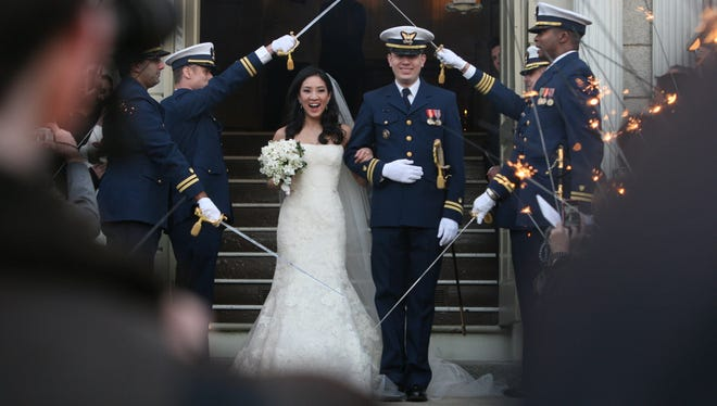 Michelle Kwan and Coast Guard Lt. Clay Pell leave the First Unitarian Church in Providence, R.I.  on Jan. 19.