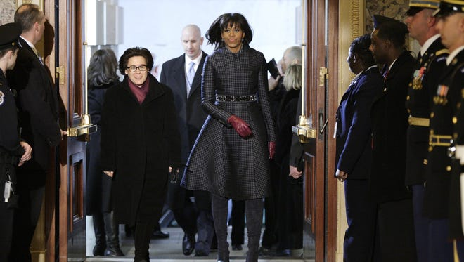 First lady Michelle Obama arrives at Capitol for swearing-in clad in a Thom Browne ensemble.