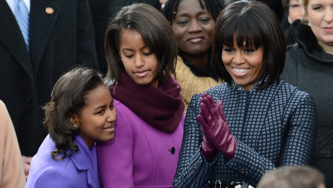 The first lady and her daughters, Sasha and Malia, at the swearing-in.