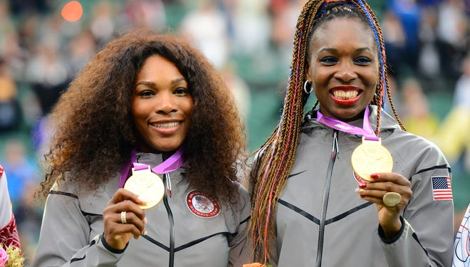 Serena Williams, left, and Venus Williams won the gold in women's doubles during the  2012 London Olympics. They have gone against each other 12 times in Grand Slam events, with Serena winning seven of their meetings.