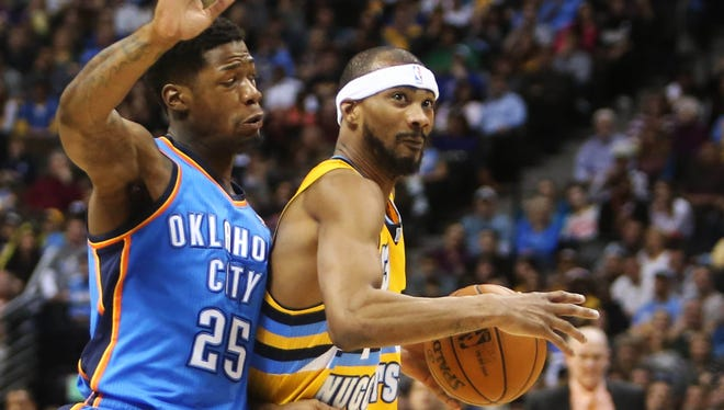 Nuggets forward Corey Brewer drives past Thunder forward DeAndre Liggins during Sunday's 121-118 overtime win.