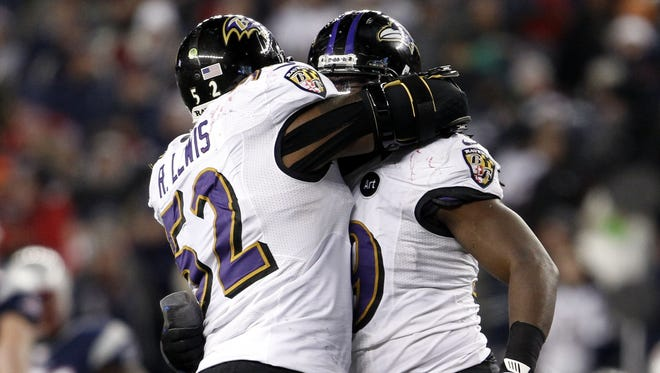 Ravens inside linebacker Dannell Ellerbe (right) celebrates with inside linebacker Ray Lewis (52) after intercepting a Patriots pass during the fourth quarter of the AFC Championship Game at Gillette Stadium.