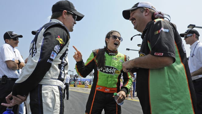 Danica Patrick jokes with Tony Eury Jr. (right) and Ricky Stenhouse Jr. during qualifying for the Nationwide Series race in Concord, N.C., May 26, 2012.