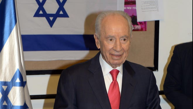 Israel's President Shimon Peres casts his vote in the general election on Jan. 22.