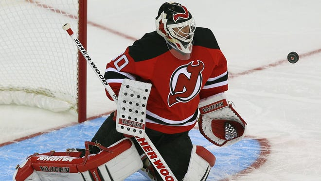 Devils goalie Martin Brodeur makes a save during the second period at the Prudential Center. Tuesday's win was also Brodeur's 120th career shutout.