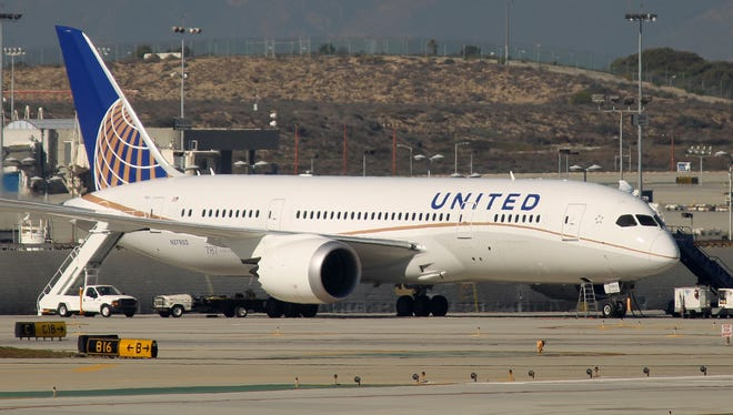 A Boeing 787 Dreamliner jet operated by United Airlines is parked at Los Angeles International Airport on Jan. 9, 2013.