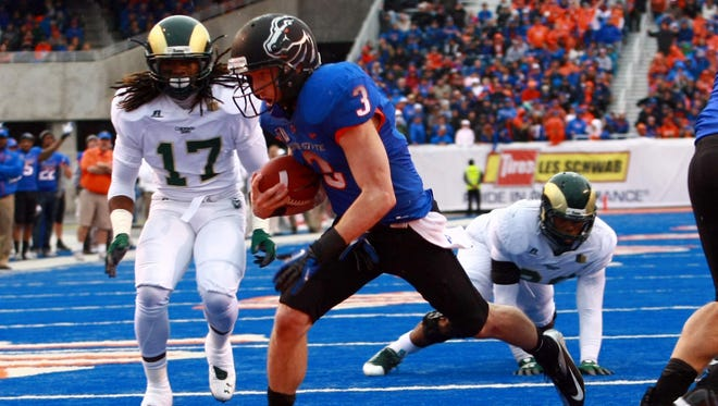 """The Mountain West Conference will split it 12 football schools into two six-team divisions, the """"Mountain"""" and the """"West."""" Boise State, which went 11-2 in 2012, will be in the Mountain Division."""
