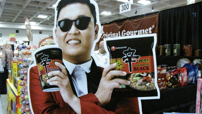 """Gangnam Style"" pop star Psy is the (cardboard) poster boy for a brand of South Korean instant noodles at the Winter Fancy Food Show  in San Francisco."