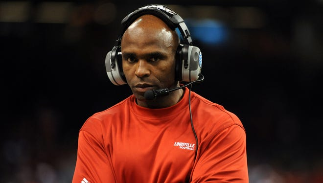 Louisville coach Charlie Strong stands on the sidelines during the second half of his team's win against Florida in the Sugar Bowl.
