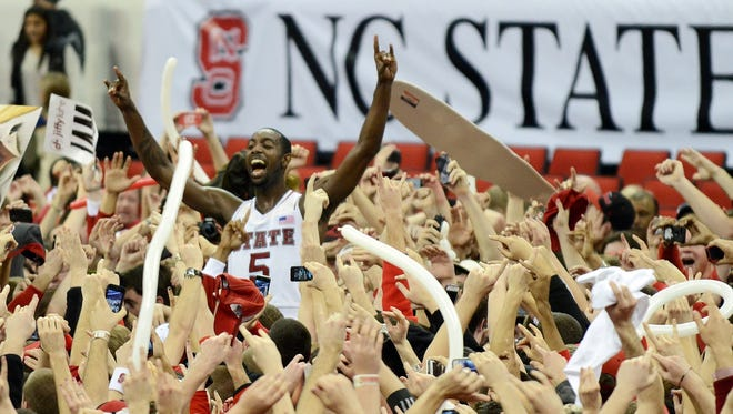 North Carolina State upsets Duke (Jan. 12, 2013): The Wolfpack beat the top-ranked Blue Devils 84-76 and N.C. State fan Will Privette stormed the court in his wheelchair. C.J. Leslie, the game's star, helped escort Privette to safety.