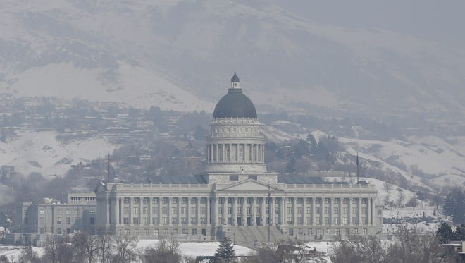 Smog hangs over the Utah State Capitol in Salt Lake City on Wednesday.