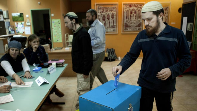 A  Jewish settler votes in the settlement of Elon Moreh in the West Bank on Tuesday.