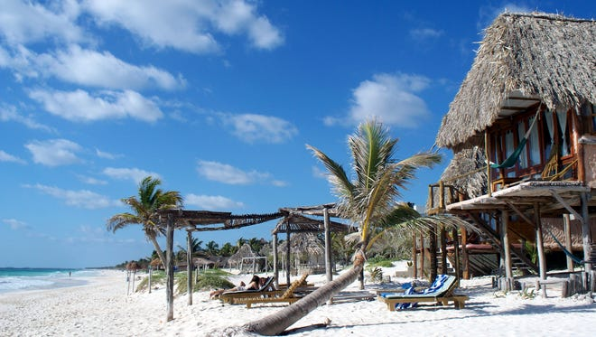 Tulum, Mexico lies at the end of the tourist stretch designated the Riviera Maya. Along this stretch of mostly undeveloped coastline, a rented bicycle sets the local pace for cruising between quiet beaches, relaxed cafes, and beachfront cabanas.