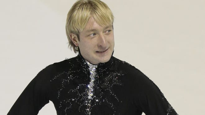 Evgeni Plushenko, of Russia, reacts after skating his short program at the  European figure skating championship ion Thursday