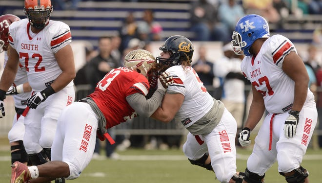 Senior Bowl South Squad defensive lineman Everett Dawkins of Florida State (93) battles with offensive lineman Brian Schwenke of Cal (57) alongside offensive lineman Larry Warford of Kentucky (67) and offensive lineman Oday Aboushi of Virginia (72) during practice on Jan. 23.