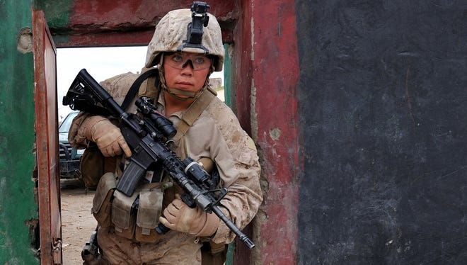 Marine Sgt. Savanna Malendoski patrols in Helmand province, Afghanistan, in February 2011. Women have routinely been serving in high-risk roles, so the historic move by the Pentagon is hardly a shock.