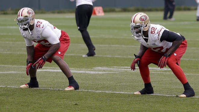 49ers linebackers NaVorro Bowman (53) and Patrick Willis (52) practice in preparation for the Super Bowl, where they anticipate having a tough challenge against the Ravens' run game.