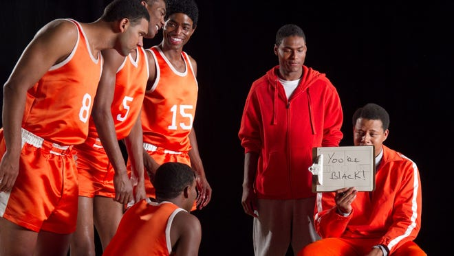 """Corey Brewer (5) and Jared Dudley (8) are coached by Terrence Howard, right, in part of Peter Farrelly's """"Movie 43."""""""