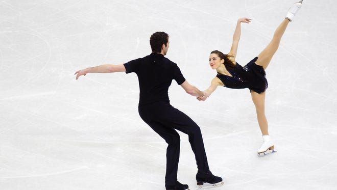 Marissa Castelli and Simon Shnapir compete during the senior pairs short program of the U.S. Figure Skating Nationals at the CenturyLink Center in Omaha on Thursday. Pairs will be a part of the new figure skating team event to debut in Sochi, Russia.