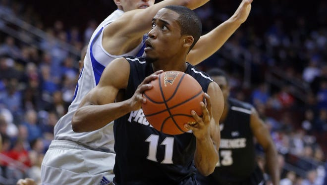 Providence Friars guard Bryce Cotton drives to the basket against Seton Hall Pirates guard Kyle Smyth.