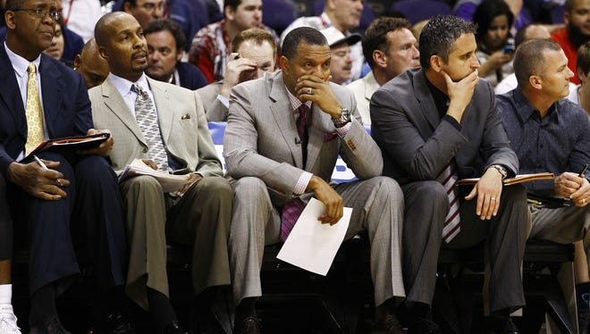Phoenix Suns assistant coach Elston Turner, center, was upset he wasn't given a shot to stay on with the team.