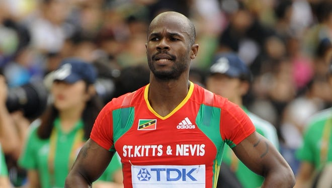 File picture shows sprinter Kim Collins of St. Kitts and Nevis. Collins' brother was killed by the police today after a domestic situation.