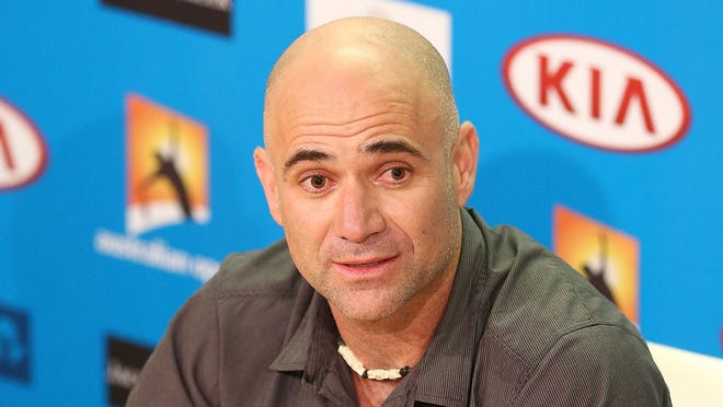 Andre Agassi meets the media during a visit at the Australian Open.