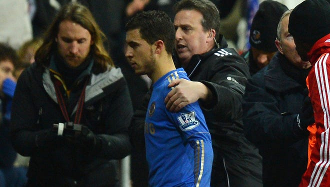 Eden Hazard is escorted off the pitch after receiving a red card in Wednesday's League Cup match.