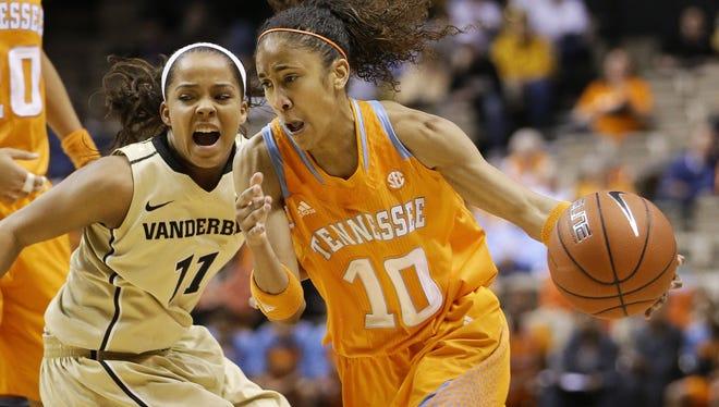 Tennessee guard Meighan Simmons drives against Vanderbilt guard Jasmine Lister in the first half in Nashville, Tenn.