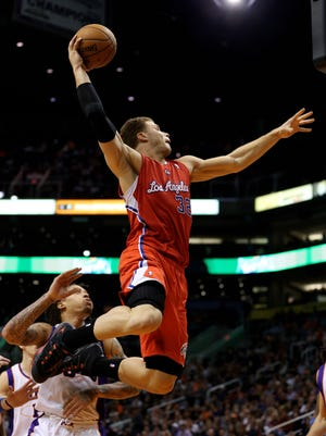 Clippers forward Blake Griffin, dunking on Jan. 24, qualified for a larger contract when he was picked by fans to his second consecutive All-Star Game.