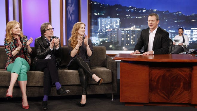 Matt Damon hosts 'Jimmy Kimmel Live' after opening the show as a kidnapper, tying Kimmel, background right, to a chair with duct tape and gagging him with his own tie, as guests Nicole Kidman, Gary Oldman and Amy Adams applaud, in Hollywood.