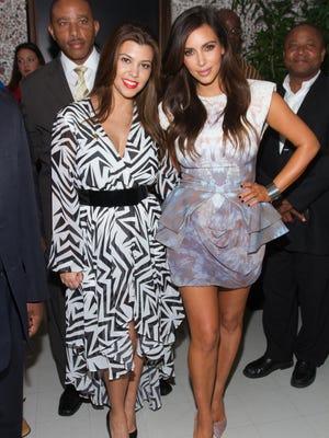 Kourtney and Kim Kardashian last November in North Miami, Fla.