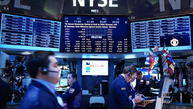 Traders work on the floor of the New York Stock Exchange earlier this month.